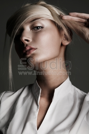 Young attractive blond female with creativity hairstyle