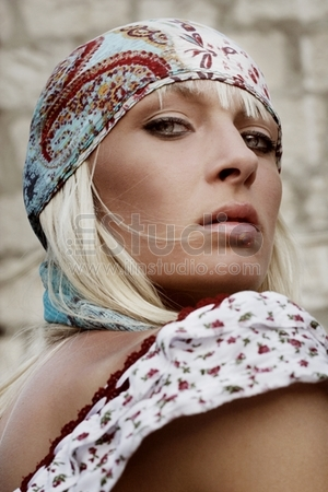 shuttePortrait of a young attractive blond beauty, hippie look