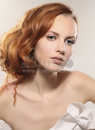 Portrait of a young woman with beautiful hair and green eyes