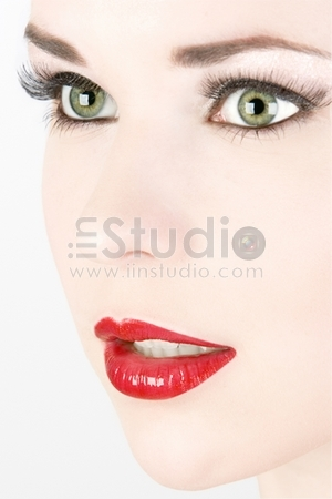 Wellness, cosmetics and chic retro style. Close-up portrait of sensuality beautiful woman model face with fashion make-up and sexy evening red lips makeup