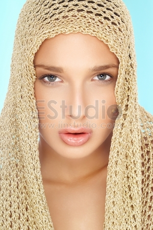 beautiful blond woman with scarf on her head