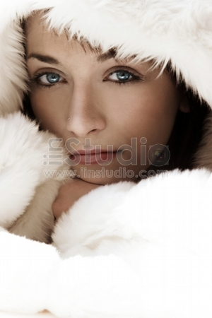 Portrait beautiful girl wearing white fur