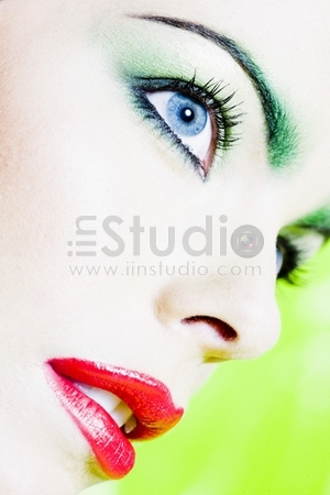 beautiful woman portrait with colorful make-up and background
