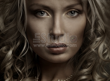 Beautiful portrait of a young woman, dark light