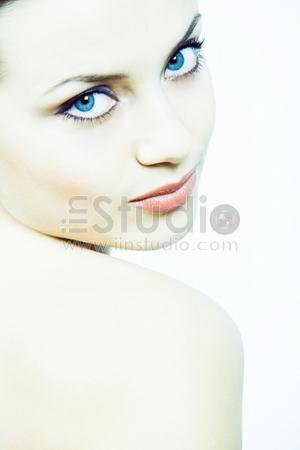 fashion concept portrait in high key technique, toned blue