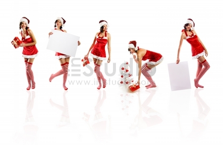smiling christmas women isolated on white background with a gift and a tree and a card