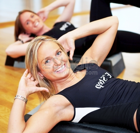 Young Pretty Women Exercising In A Fitness Center