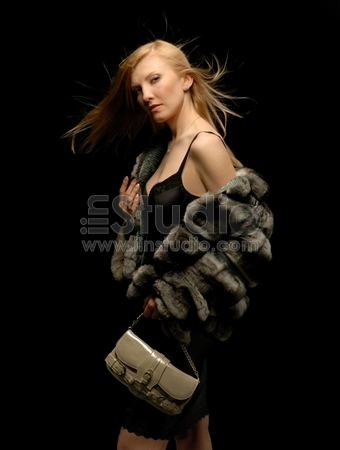 Blond Girl in Fur Coat looking sideways
