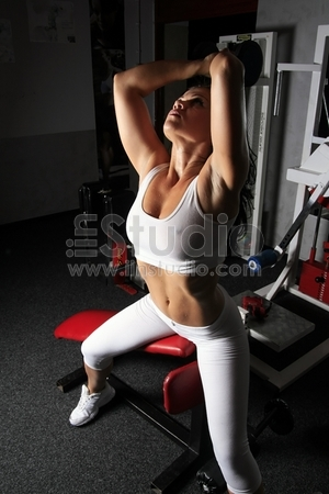 fitness girl is working out with weights