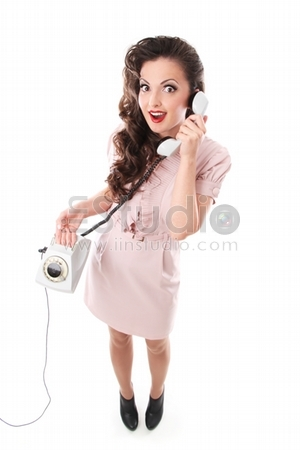 girl in a dress talking on the phone and wonders
