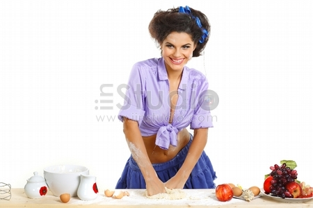Photo of beautiful sexual brunette on a kitchen in style of pinup