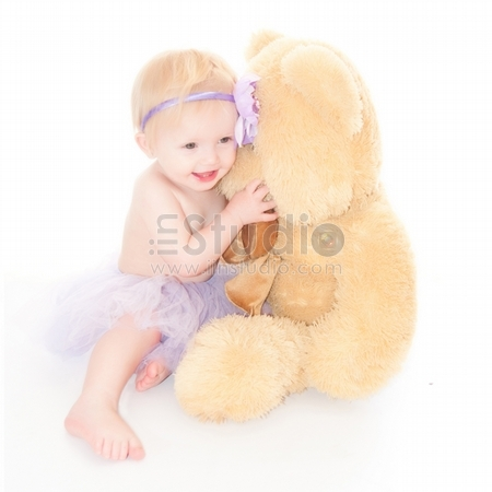 Portrait Of A Sweet Infant With Her Bear