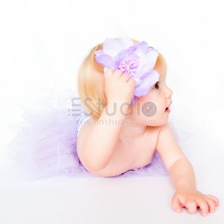 Portrait Of Sweet Baby Girl Wearing In Purple Tutu