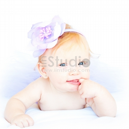 Portrait Of Sweet Baby Girl Wearing In Purple Tutu