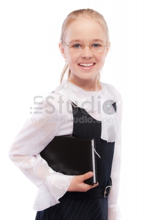 Young smiling schoolgirl holds textbook, isolated on white background