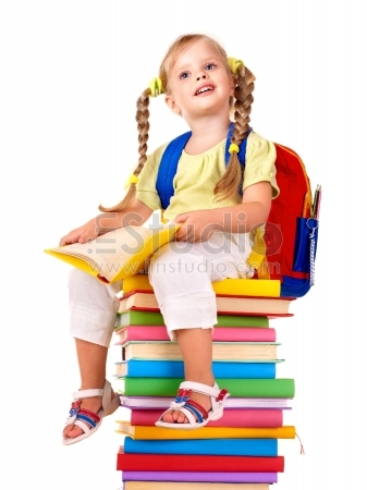 Little girl sitting on pile of books - Isolated