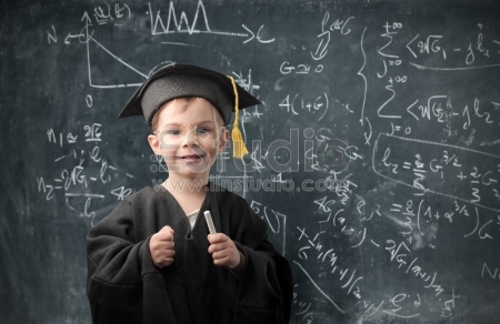 Smiling child with graduate suit