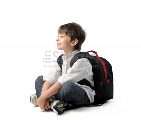 Smiling child with rucksack sitting