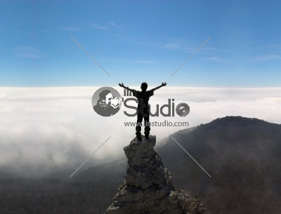 Man on the top of a rock - vision mission
