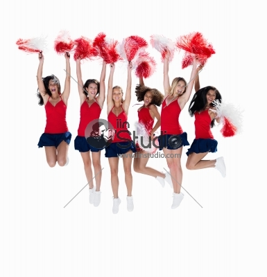 Happy Young Cheerleaders Team Jumping In Mid Air On White Background