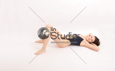 Sexy fit woman with healthy clean skin lying down