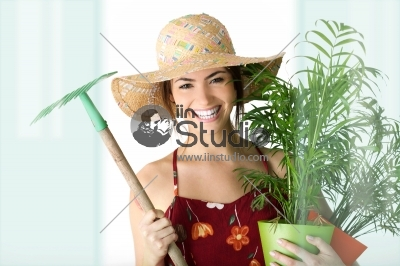 Gardening girl portrait with plant
