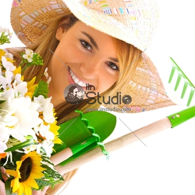 young blond girl portrait with gardening tools