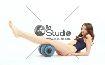 Pretty young girl fitness workout with dumbbell